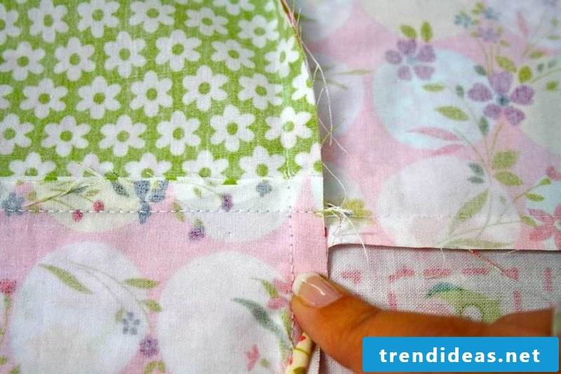 Sew on patchwork blanket. Sewing step