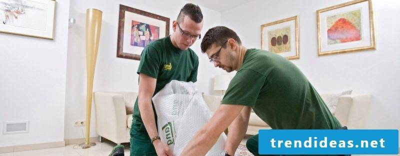 What does a removal service offer and why is a forwarding company useful?