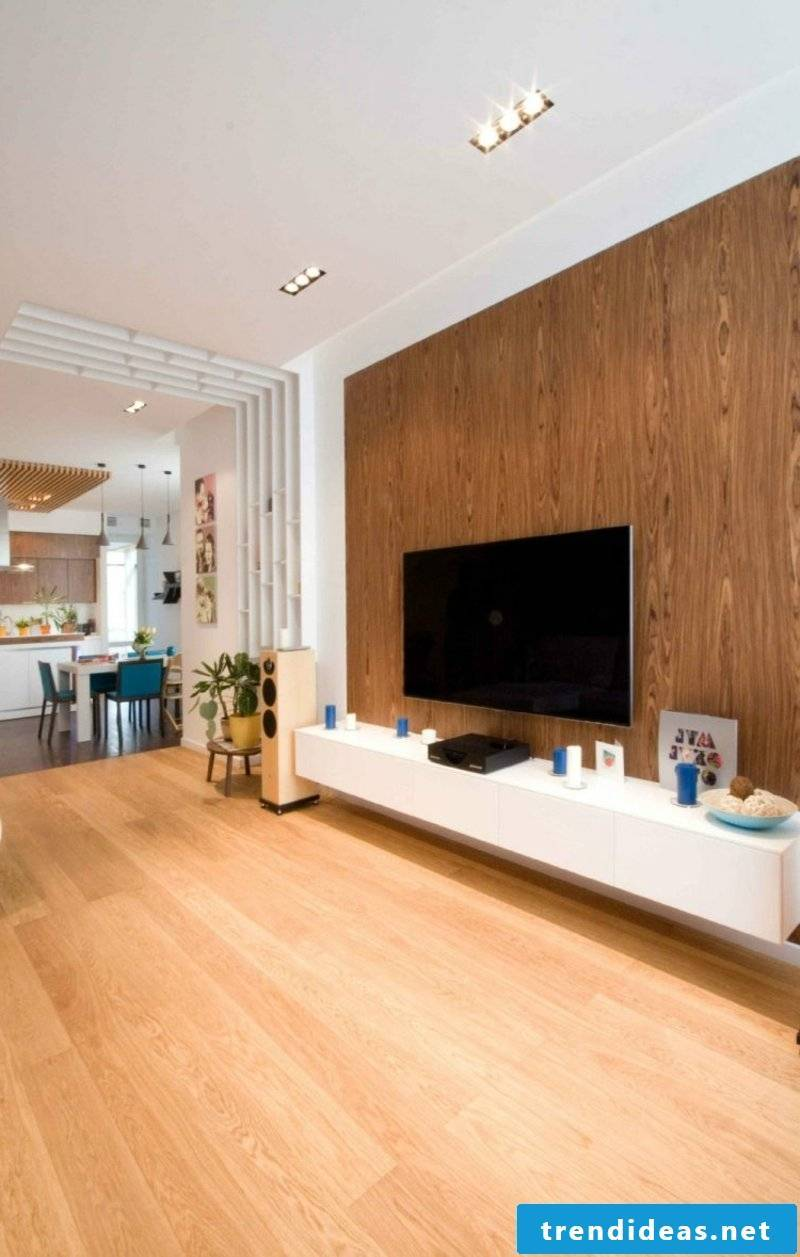 Living room floor and wall cladding made of wood