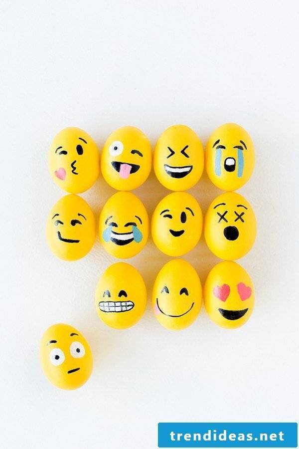DIY Emoji Funny Eggs Faces: Create this fun ensemble of emoji faces together.