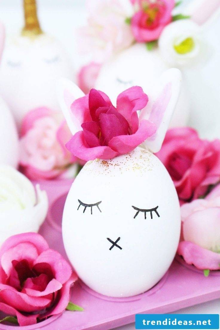 Sweet white easter egg with floral decoration