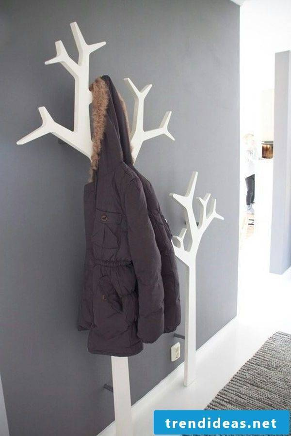 The hallway is designed with the help of a stylish wardrobe