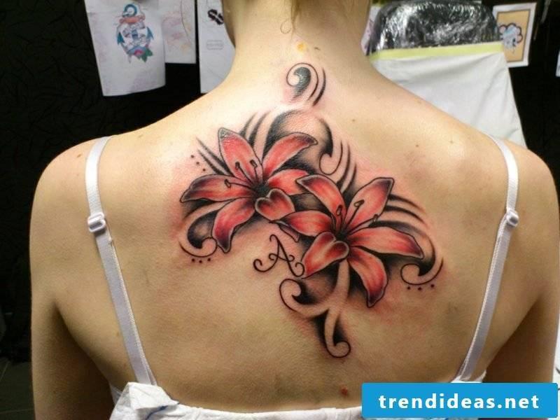 Lilies tattoo back creative design ideas
