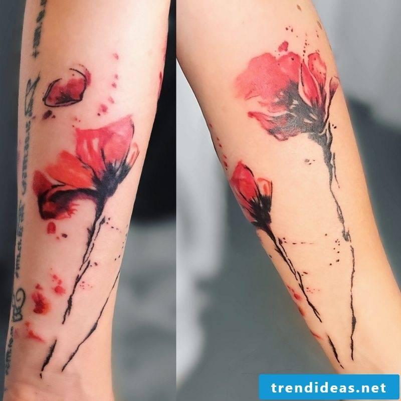 Watercolor tattoo on leg flower