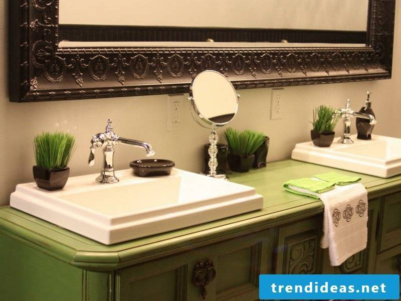 grass and green cupboard in vintage bathroom