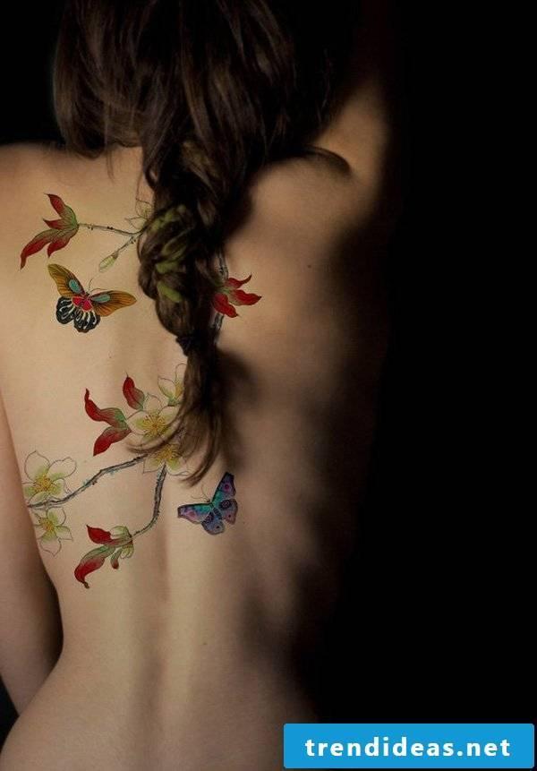 Tattoo butterfly on flower