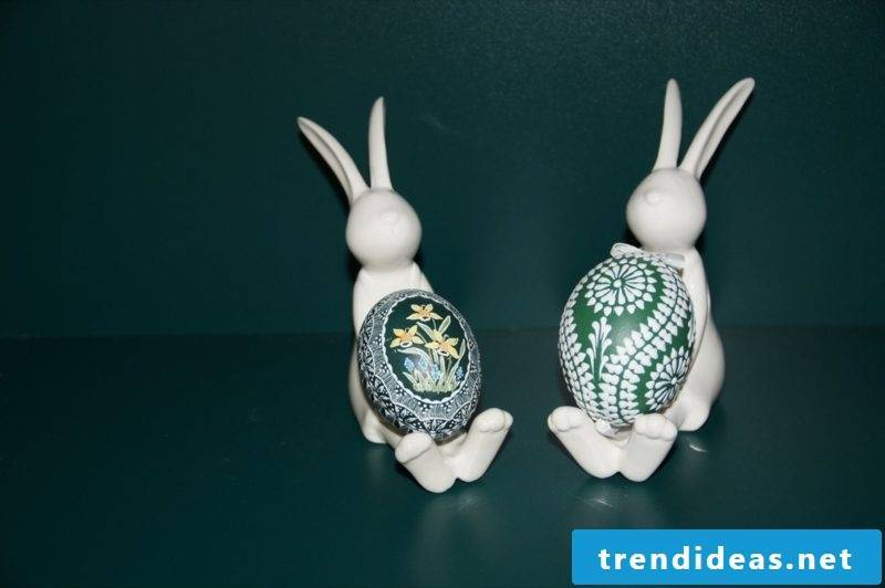 Sorbian Easter eggs scratching technique and two Easter bunnies from porcelain
