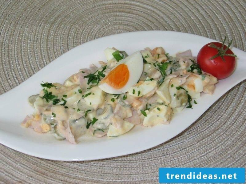 Egg salad tasty with ham and mayonnaise