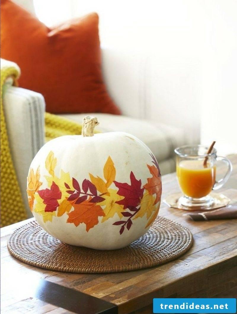 Tinker with children decorate autumn pumpkin