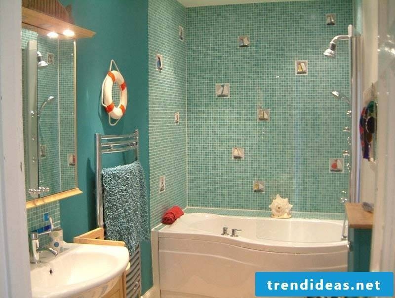 bathroom design ideas for family bathroom in blue color with sweet ornament on the walls