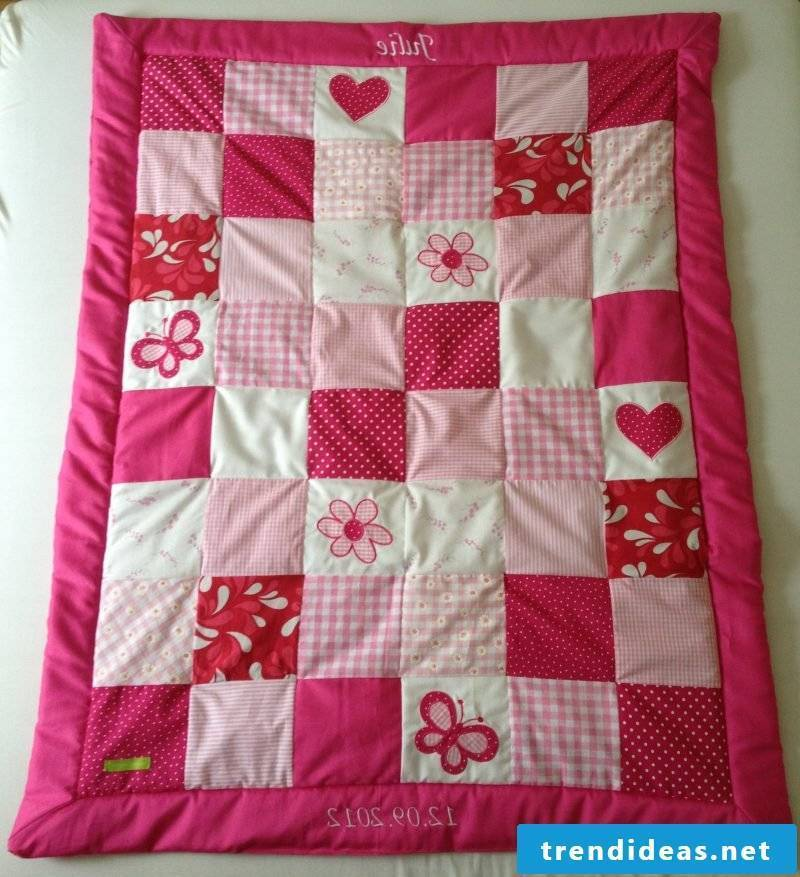 Sew on patchwork blanket for girls