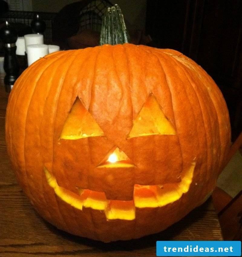 After cutting out the pumpkin templates, insert light
