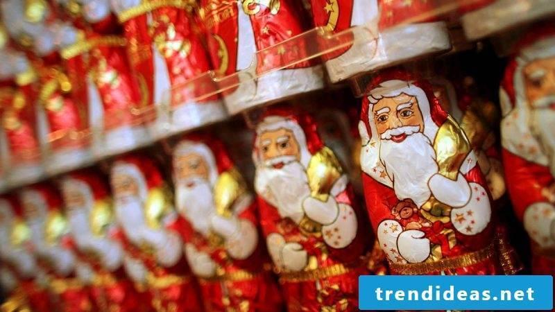 Santa Claus presents chocolates Santa Claus