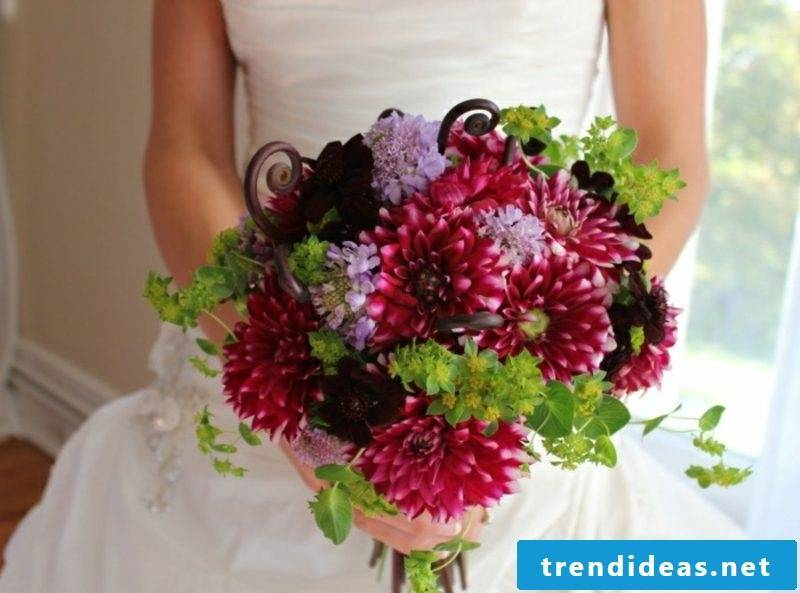 Bridal bouquet of roses and dahlias
