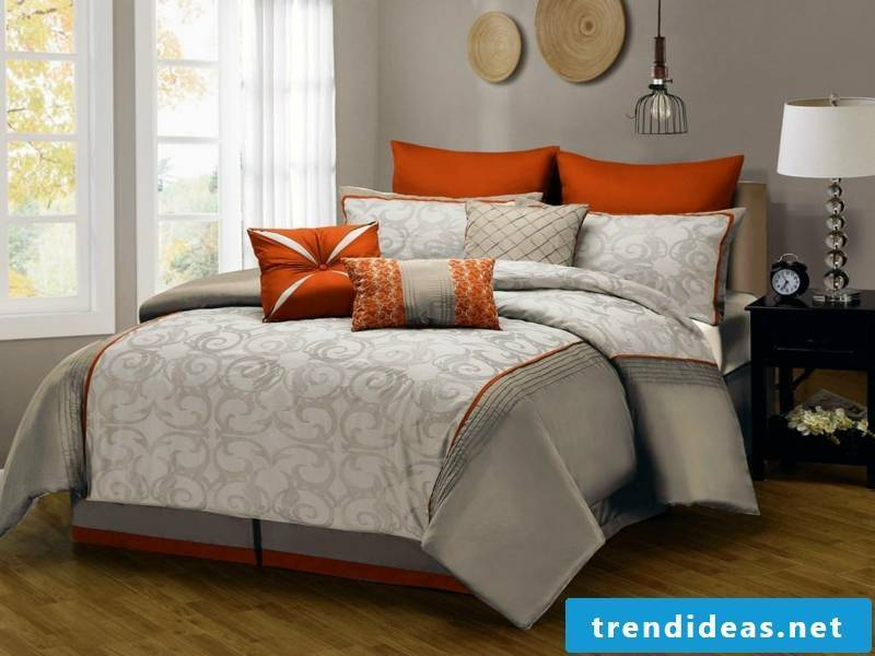 gray luxury bedding with red accents