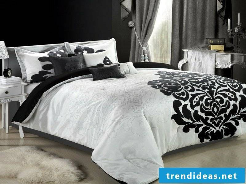 luxury white bed linen with black sheets