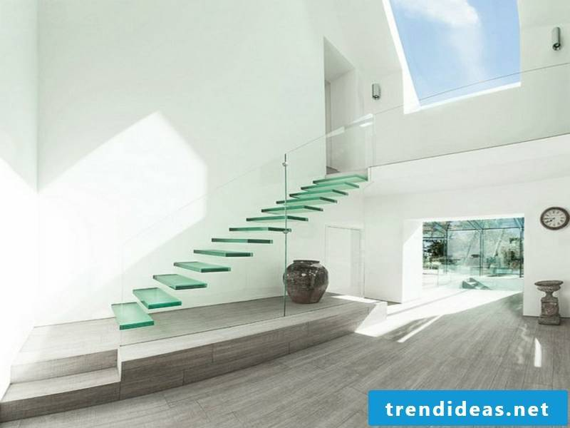 floating glass staircase and white walls