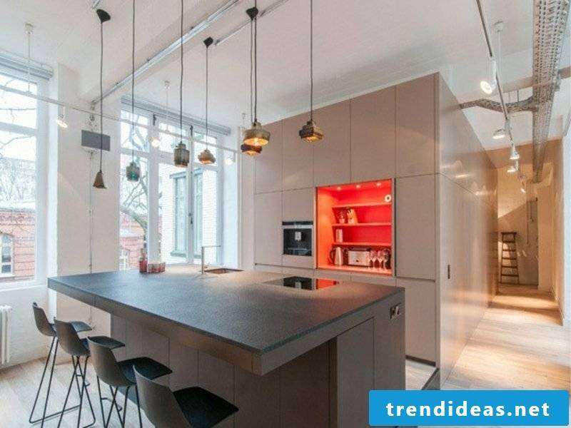 designer hanging lamps over the kitchen island