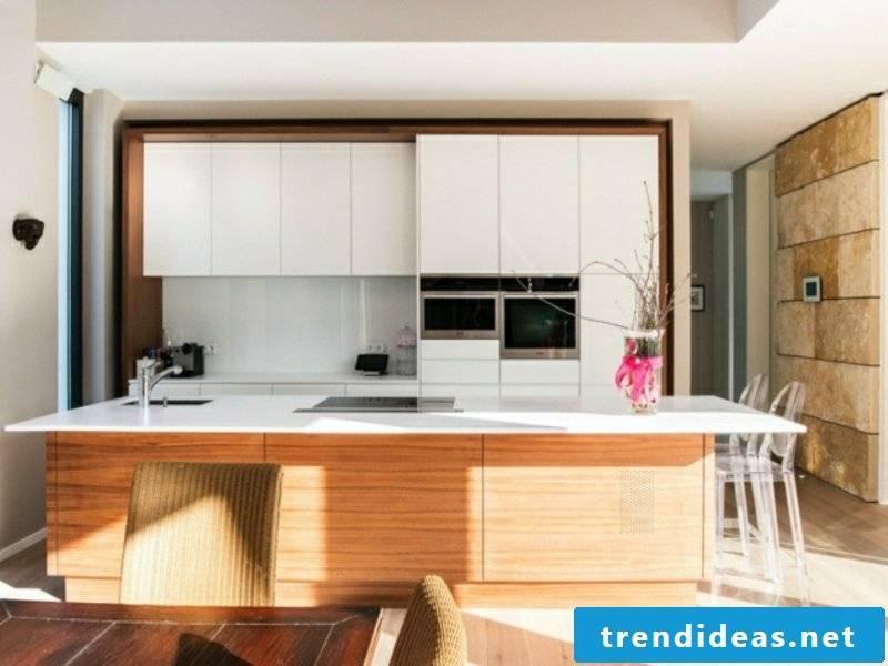 designer white cupboards over the kitchen island