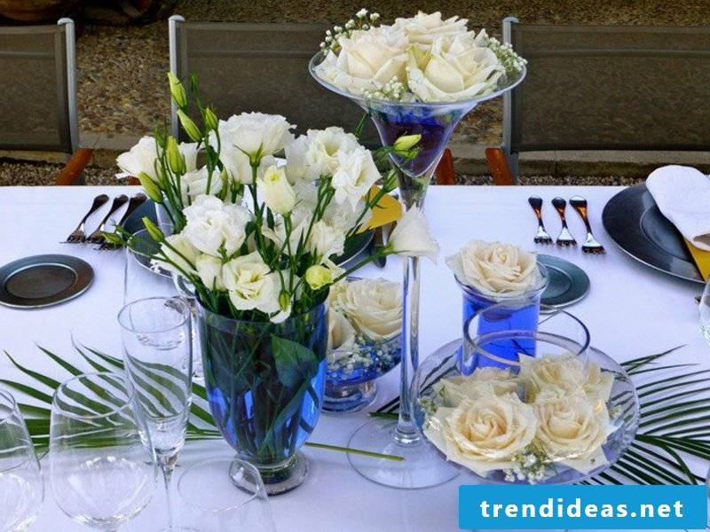 table decorations with roses in glass vases
