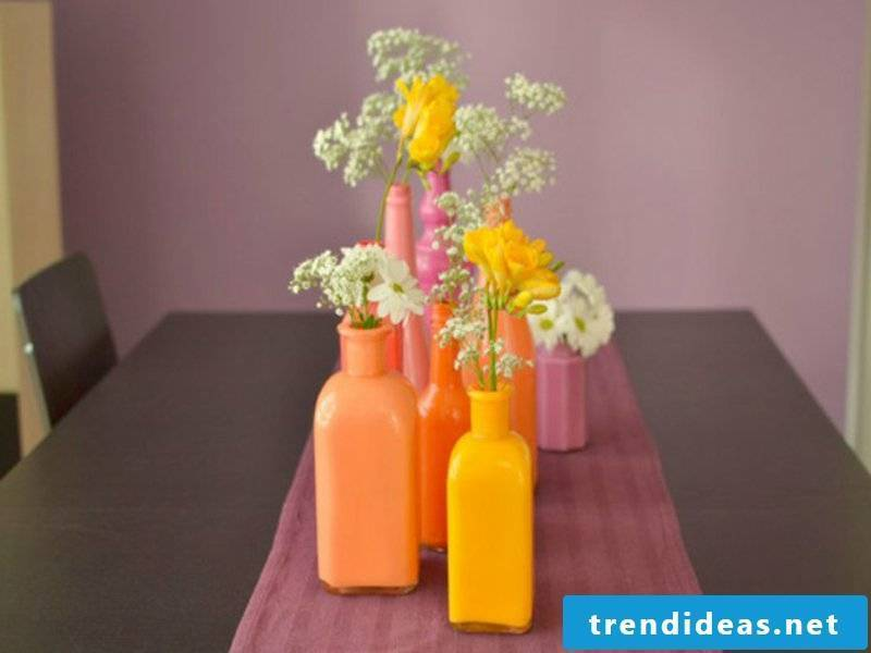 table decorations in orange with flowers