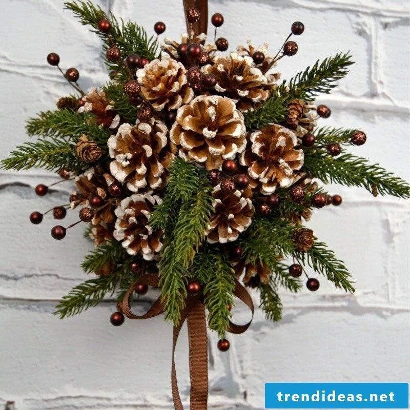 Tinker with pinecone door decoration