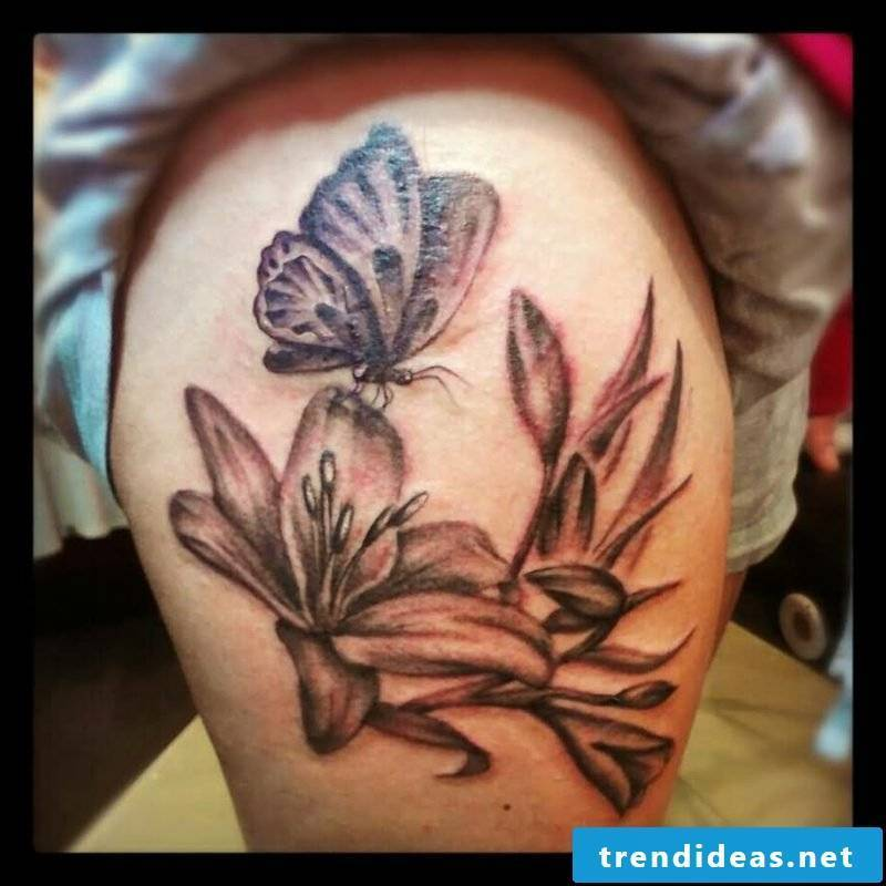 Lilies tattoo on the leg