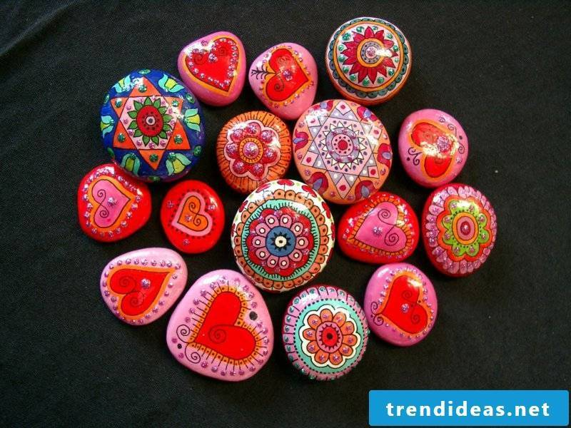 painted stones in pink and red