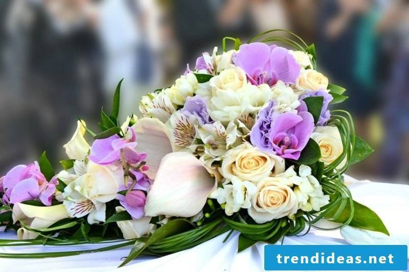 Floral arrangements of roses and orchids