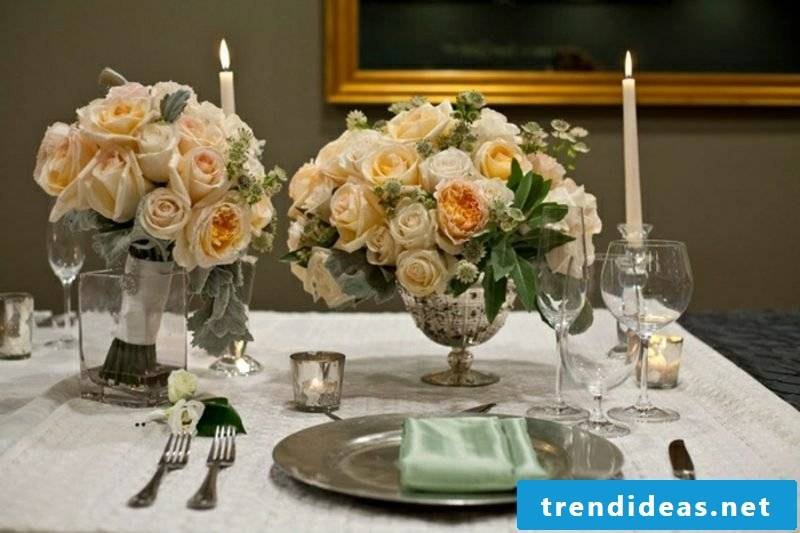 Floral arrangements roses candles table decoration