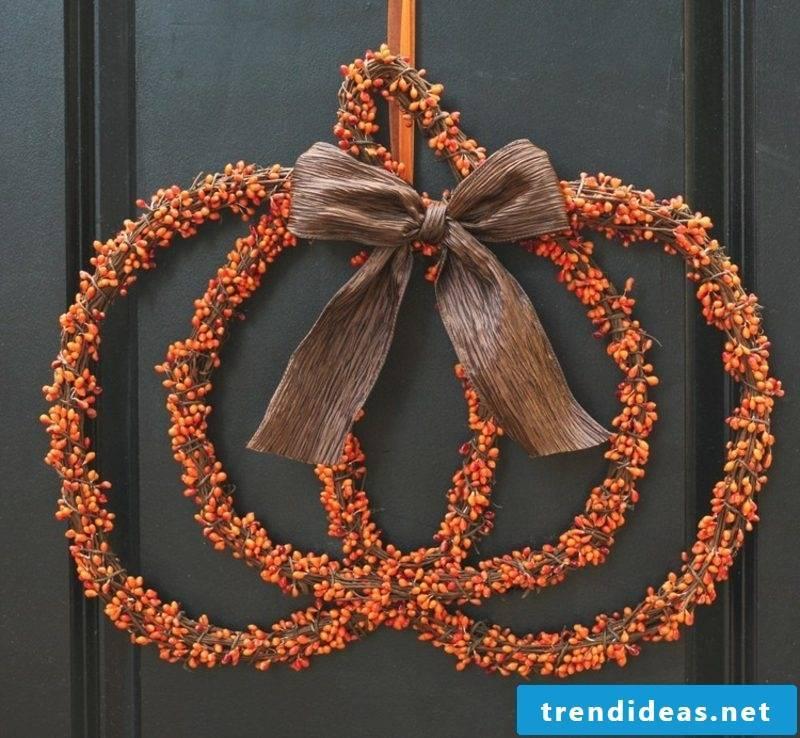 Autumn decoration for the entrance door wreath original pumpkin