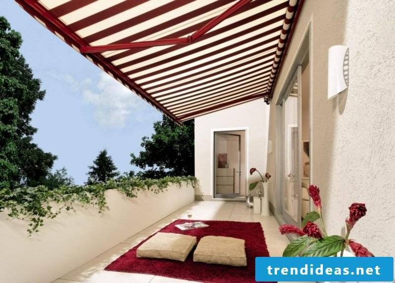 original balcony awning with red and white stripes