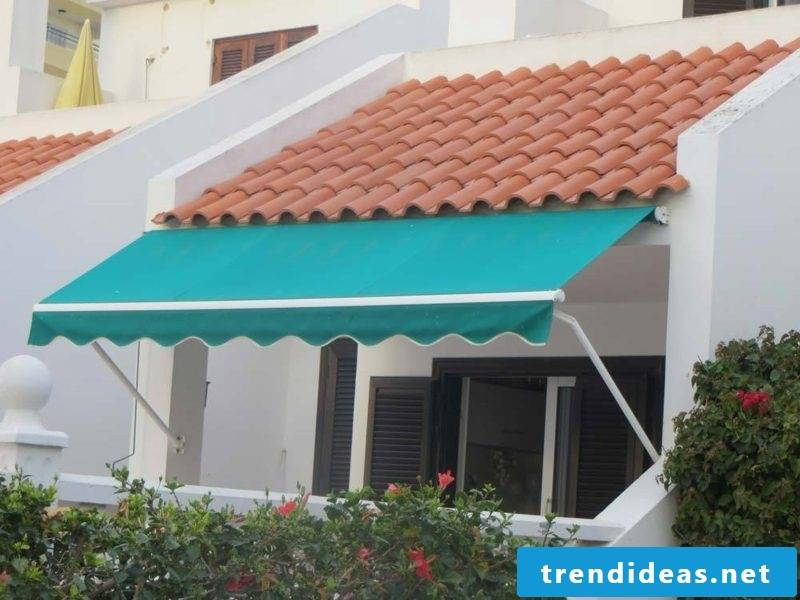 blue articulated arm awning balcony