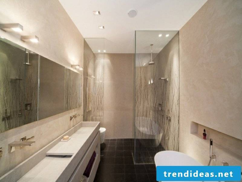 Glass shower and beige walls in the bathroom design