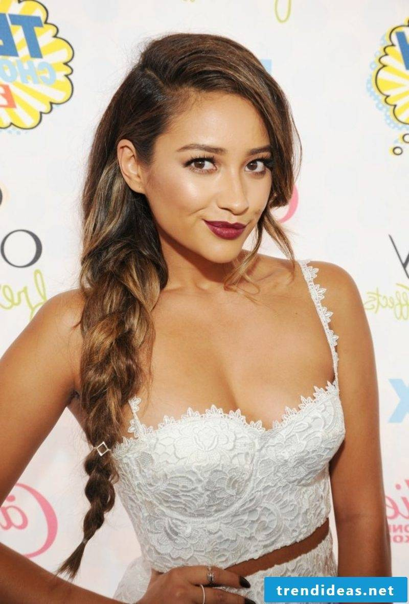 light brown hair Shay Mitchell braiding over one shoulder
