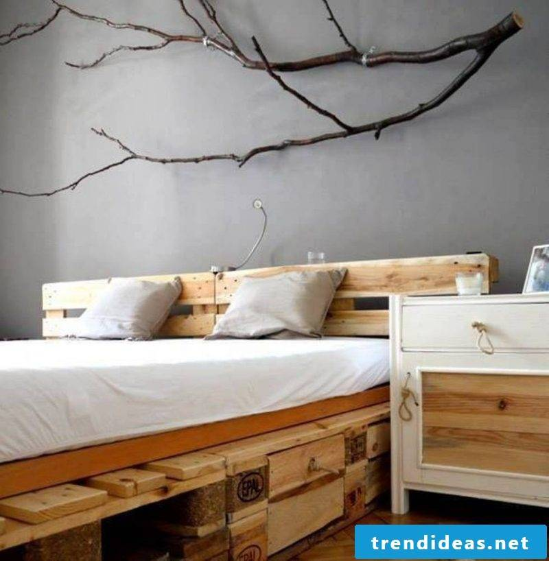 Bed made of europallets in rustic style