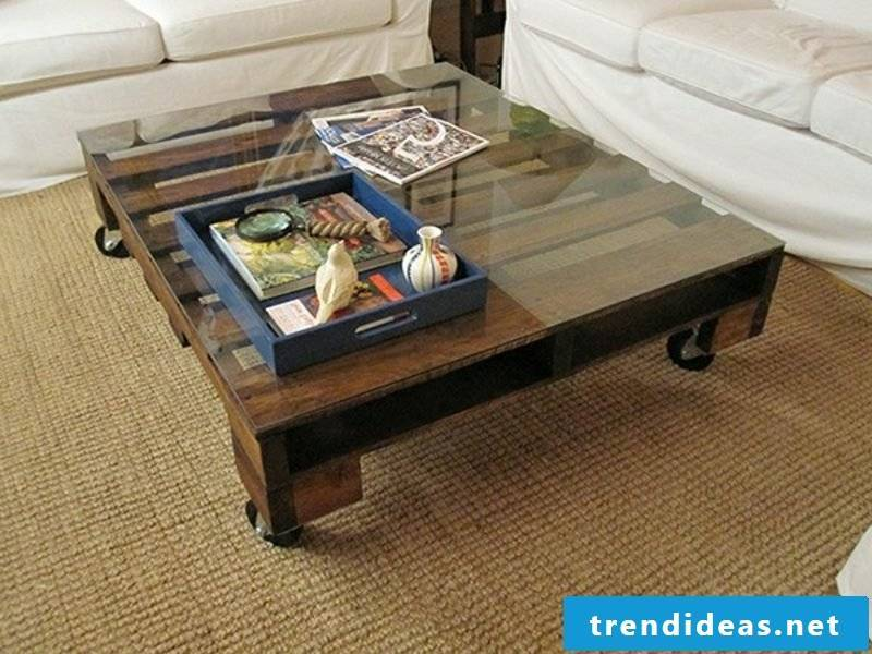 Wooden coffee table with glass top