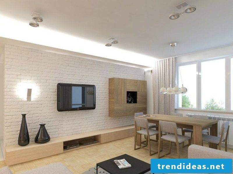 TV, mounted on white brick wall dining room