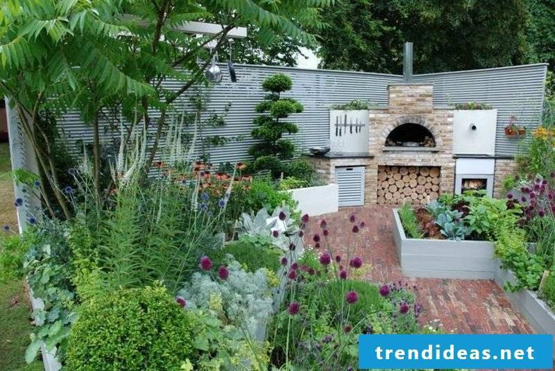 modern barbecue fireplace made of stone with firewood department