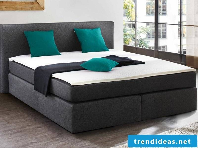 Queen size bed in English box spring bed