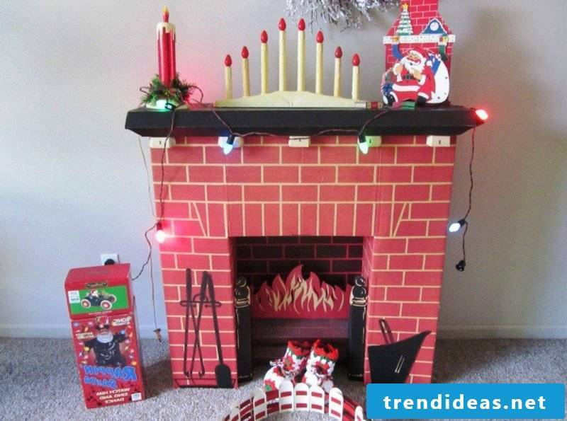 Decorative fireplace made of cardboard for Christmas