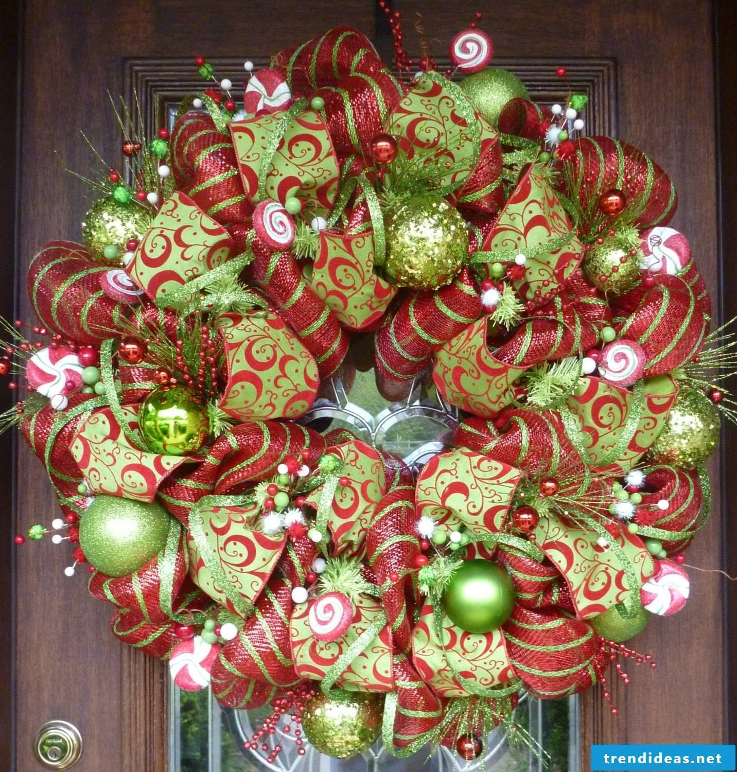 Christmas door wreath from decoration and net loops