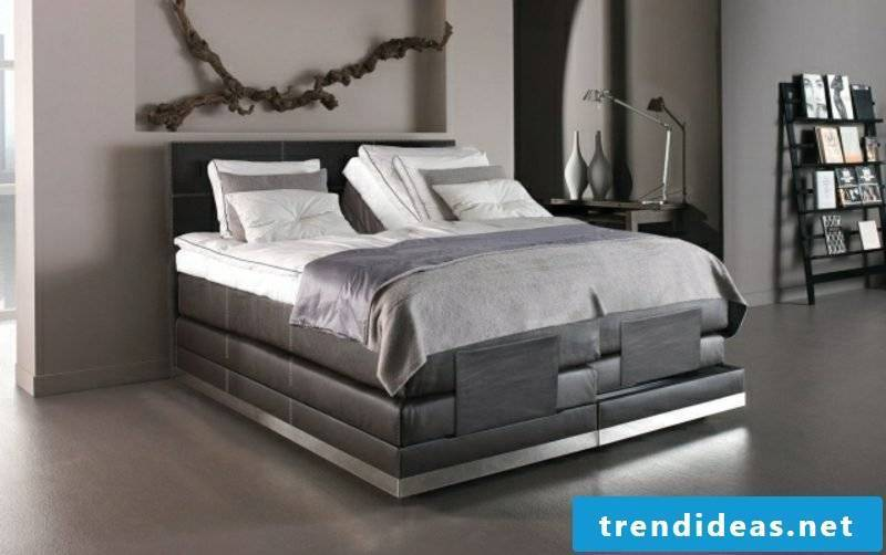 Boxspring bed original leather upholstery in dark gray