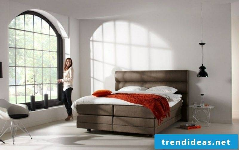 high box spring bed with brown upholstery