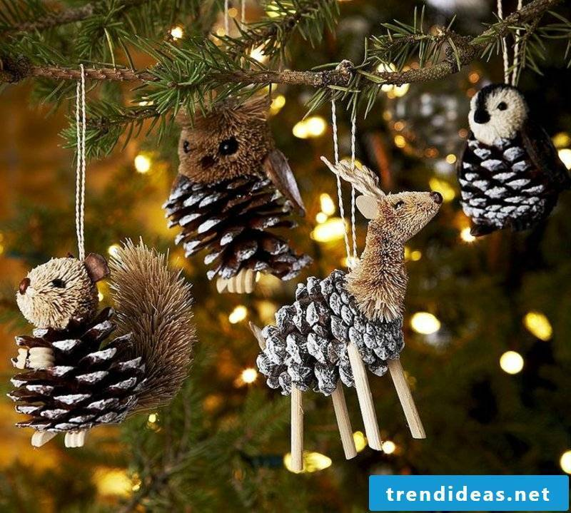 Decorating Christmas tree with pine cones