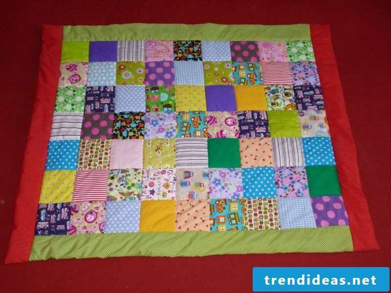 Sew on patchwork blanket. Colorful