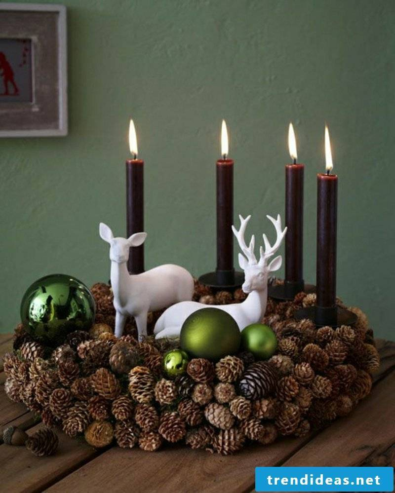 Christmas tree wreath and candles with pinecone