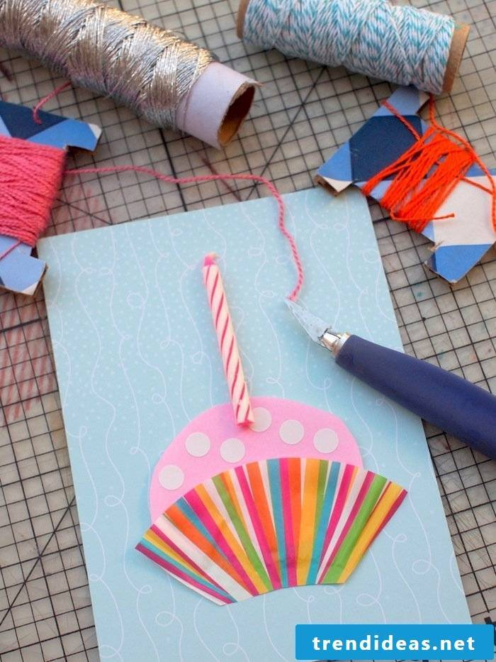 birthday cards made by yourself on blue cardboard with a candle glued