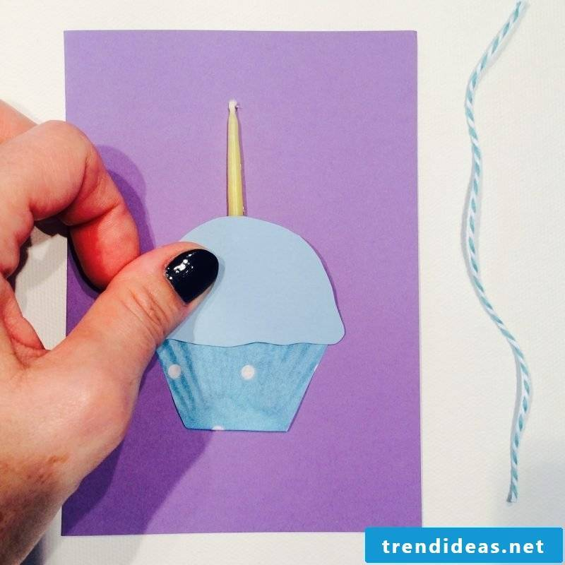 birthday cards design card with a blue cupcake and a candle