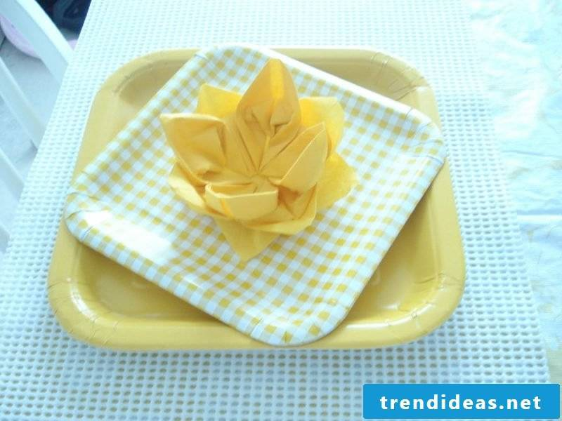 Yellow flowers from the napkins.